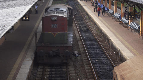 Diesel locomotive switches tracks at local station in Sri Lanka Live Action