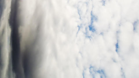 Vertical video. Clouds quickly rush on the sky. Time Lapse Footage