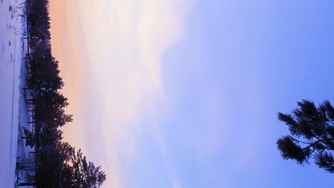 Vertical video. Sunrise over the farmhouses. Winter. Time Lapse Footage