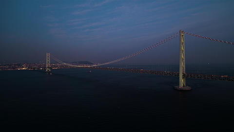 Aerial - Full view of the Akashi Kaikyo Bridge right after sunset Zoom in ライブ動画