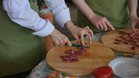 Multiple people slices Raw Meat On Wooden Board Archivo
