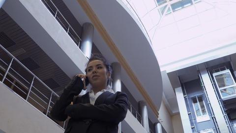 Beautiful businesswoman talks on phone Footage