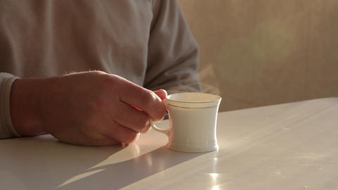 Man Drinking Hot Tea From A Cup stock footage