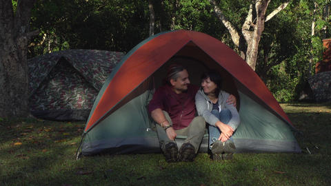 two people sitting in the morning in tent in jungle Footage