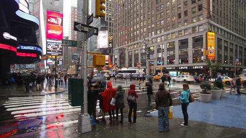 Busy intersection on a rainy evening on 42nd street at a busy street crossi Live Action