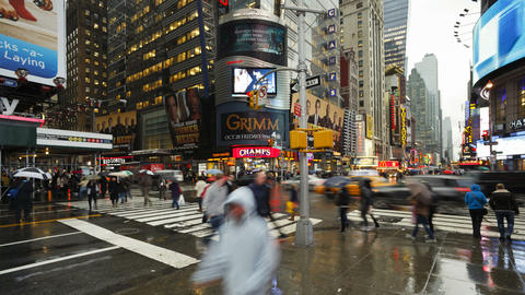 Busy intersection on a rainy evening on 42nd street at a busy street crossi Footage