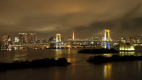 Day to night transitions tokyo tower and rainbow bridge at night viewed Live Action