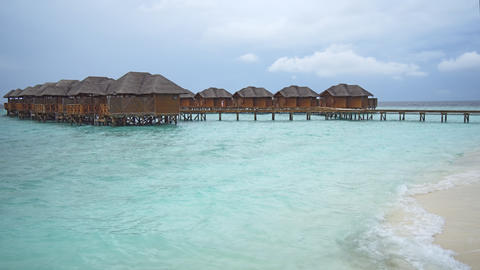 Thatched Roof Villas over Water at Resort in the Maldives Footage