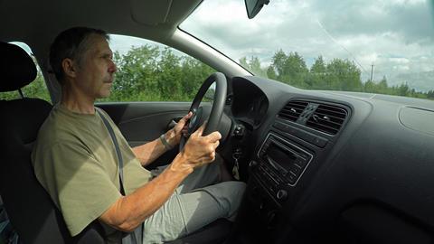 Man Driving a Car along a Rural Highway. Video 4k UltraHD ライブ動画