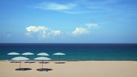 Umbrellas Arranged on Tropical Surin Beach in Phuket Thailand Footage