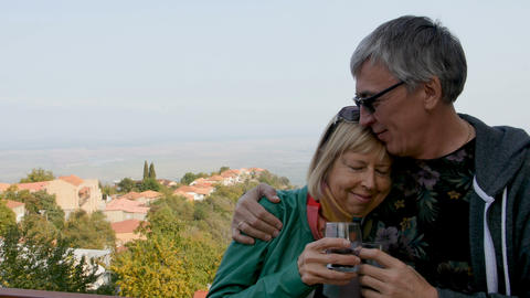 Happy, smiling mature couple drinking wine outdoors. Hugs, happy long life Footage