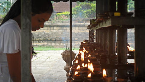 Local Woman Praying and Performing Ritual at a Hindu Temple in Kandy Footage