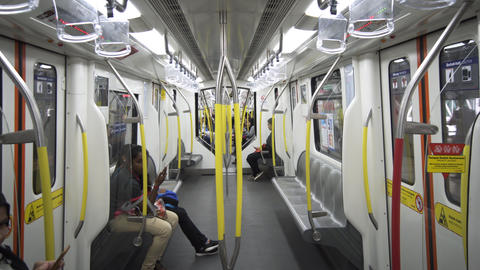 Passenger perspective of a ride on a rapidKL commuter train Live Action