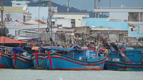 Fishing wooden ships in the background of the city. Nha Trang. Vietnam Footage