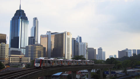 RapidKL elevated commuter train approaching. Video 4k UltraHD Footage