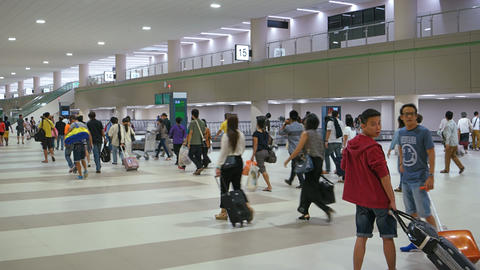 Travellers passing the baggage carousels at Don Muang International Airport Footage