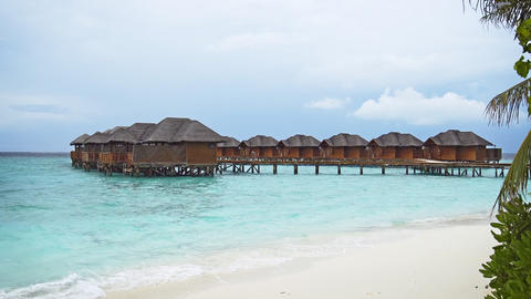 Thatched Roof Bungalows over Water at Resort in the Maldives Footage