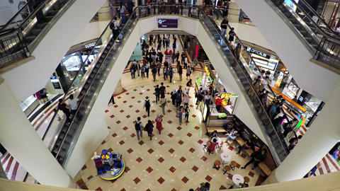 Escalators inside Suria KLCC shopping mall in Kuala Lumpur Footage