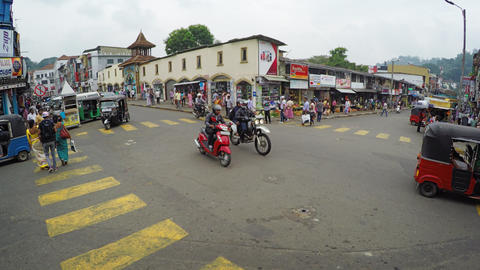 Vehicle and pedestrian traffic at typical. uncontrolled intersection in Kandy Footage
