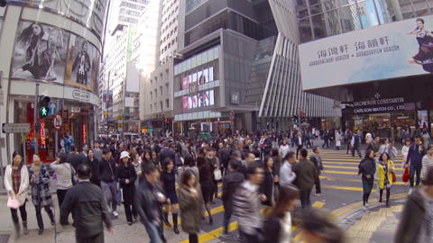 Crowd at the foot of skyscrapers. Hong Kong Footage