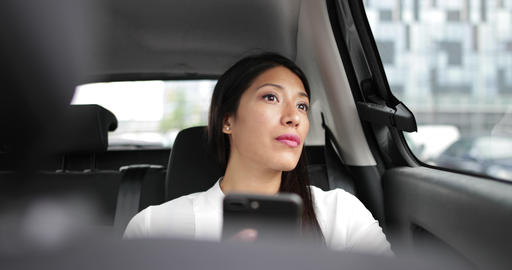 Businesswoman looking out of window of taxi cab Footage