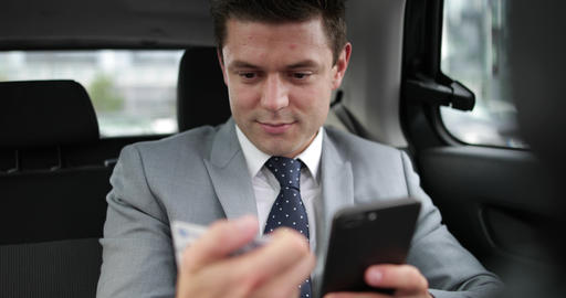 Businessman paying via app for taxi cab ride Footage