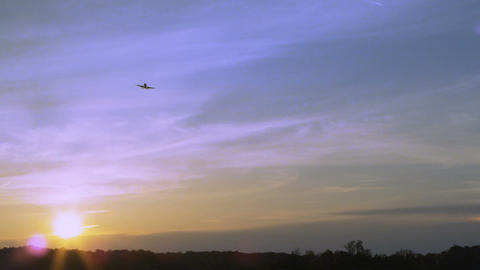 Plane soaring over sunset sky Footage
