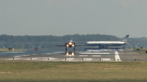 Plane taking off while plane prepares Live Action