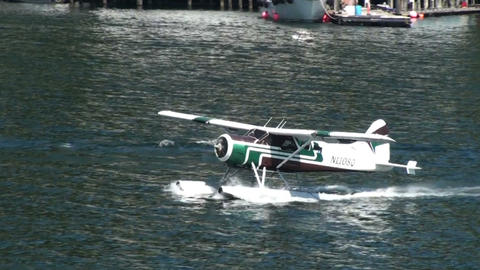 Seaplane gaining speed in water for takeoff Footage