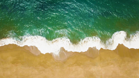 Top view of a deserted beach. The Portuguese coast of the Atlantic Ocean Filmmaterial