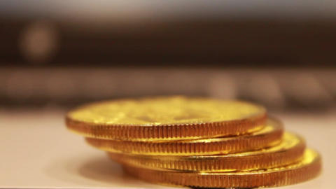 golden bitcoins lie in a pile, they spread a ladder of coins, one by one Footage