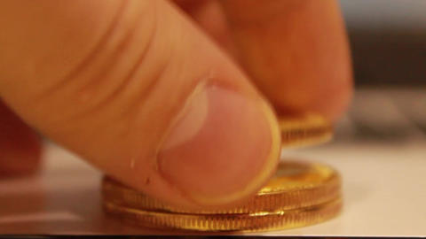 Gold bitcoins lie in a pile, they spread a column of coins one by one Live Action