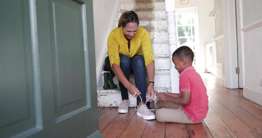 Boy learning to tie shoe laces Footage