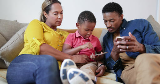 Family playing games on smartphone Footage