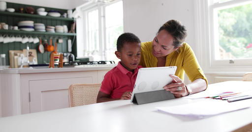 Mother teaching Son how to use digital tablet Footage