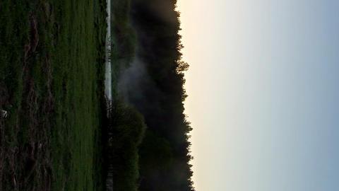 Vertical video. Sunrise. Time Lapse Footage