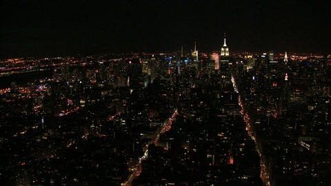 Aerial bustling city streets and skyline Footage