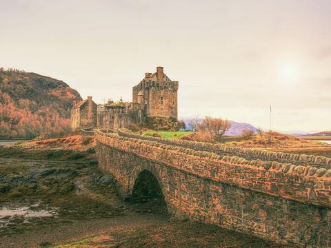 Tides in the lake at Eilean Donan Castle, Scotland. The popular stony bridge Photo