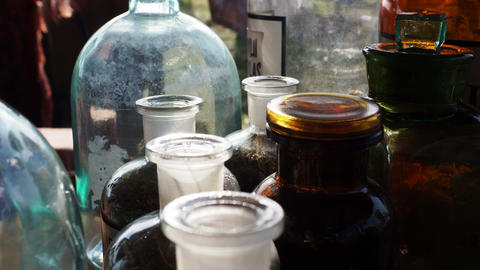 Jars and bottles of herbs Stock Video Footage