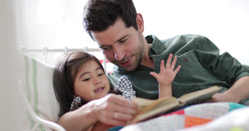 Father reading Daughter a bedtime story Live Action