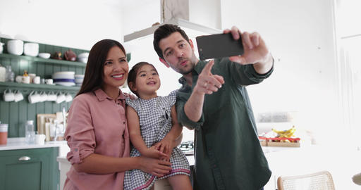 Family taking a selfie with a smartphone Footage