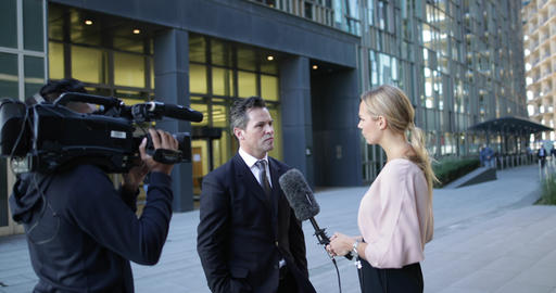 News presenter interviewing live on the street Live Action
