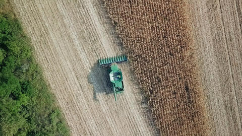 Harvesting of corn. Harvester gather corn from the field. Russia, From Dron, Live Action