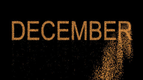name of the month DECEMBER appears from the sand, then crumbles. Alpha channel Animation