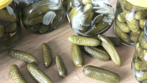 Glass jars with pickled cucumbers. Marinated pickled cucumbers Footage