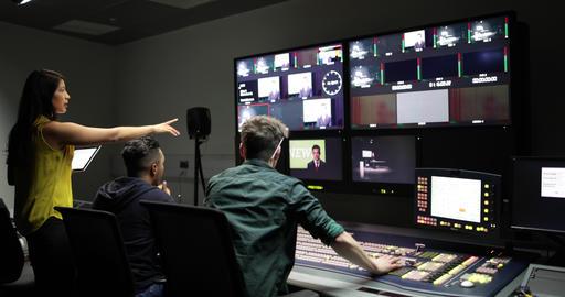 Operators in a control room at a television studio ライブ動画