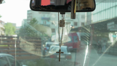 Cross hanging from the mirror in the car Footage