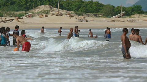 Local people wading and swimming at a Kirinda beach Footage