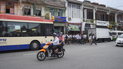 Public school students boarding a city bus after class in George Town Footage