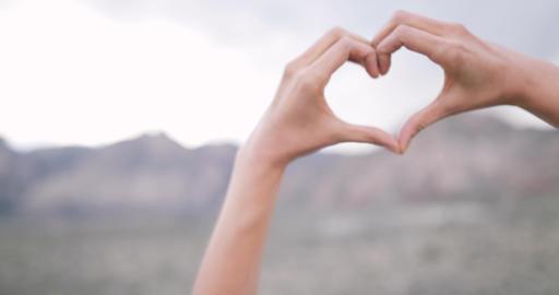 Female making heart shape symbol Footage